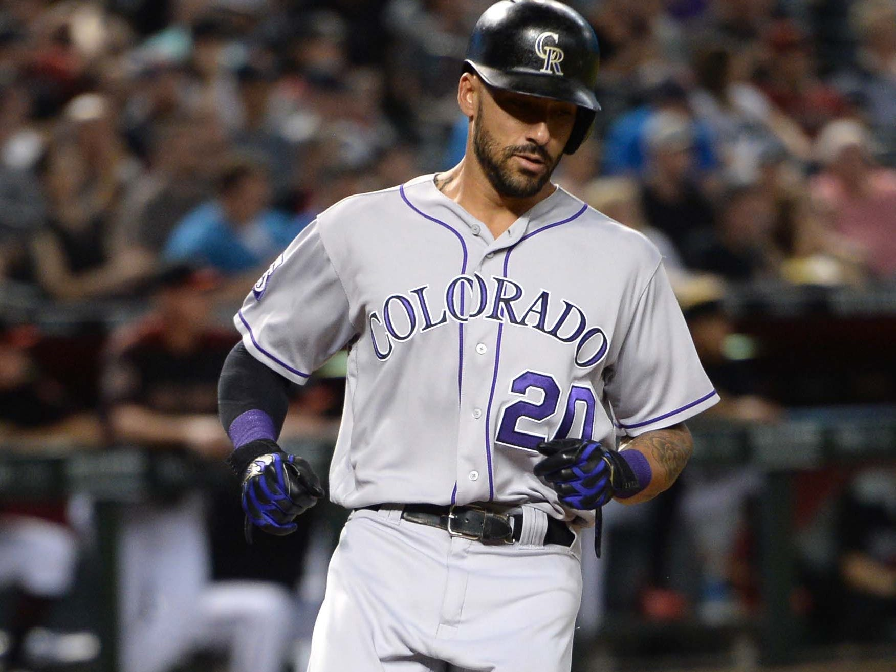Sep 22, 2018; Phoenix, AZ, USA; Colorado Rockies first baseman Ian Desmond (20) scores a run against the Arizona Diamondbacks during the third inning at Chase Field.