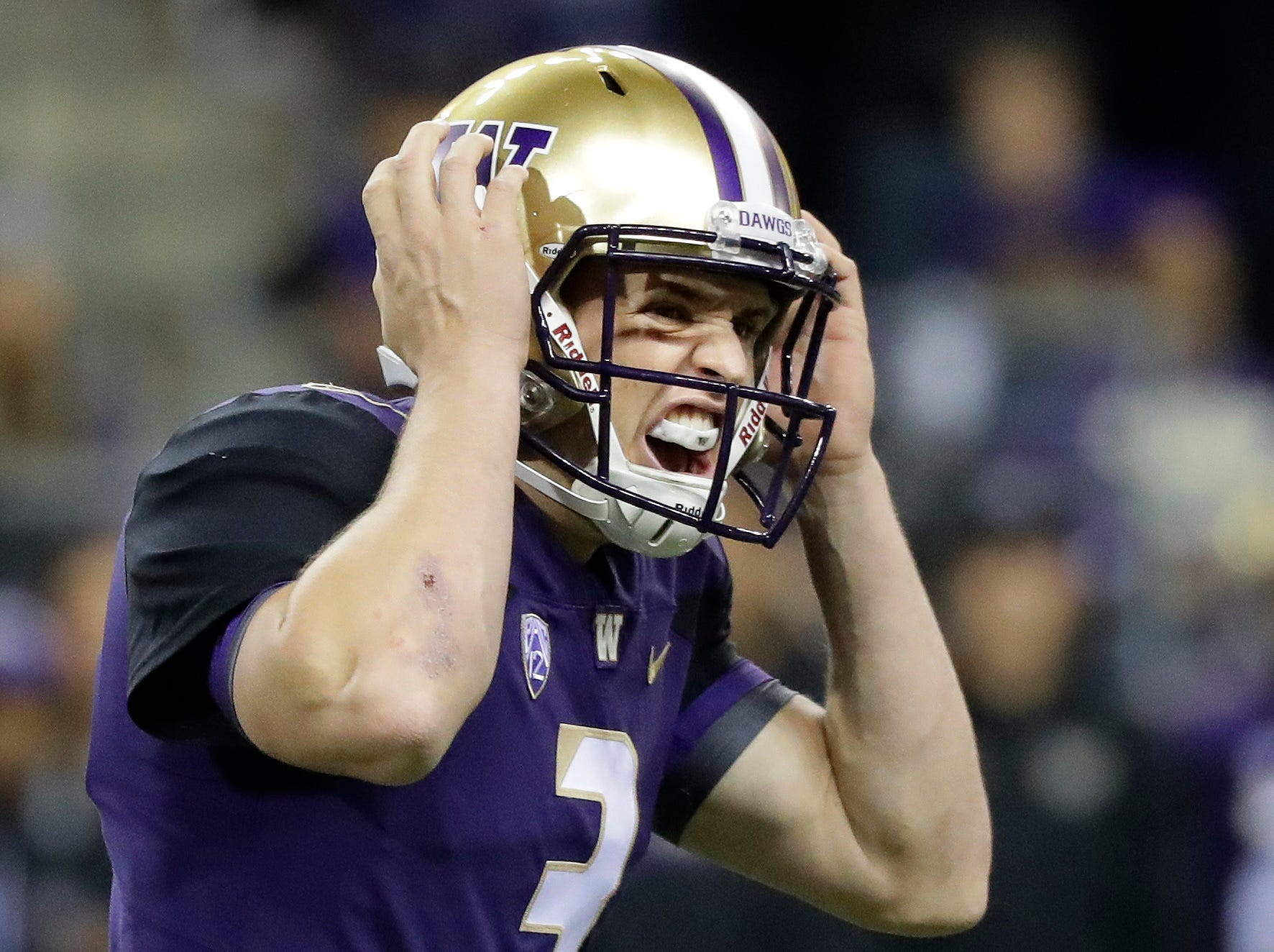 Washington quarterback Jake Browning calls to his team at the line of scrimmage during the first half of an NCAA college football game against Arizona State, Saturday, Sept. 22, 2018, in Seattle.