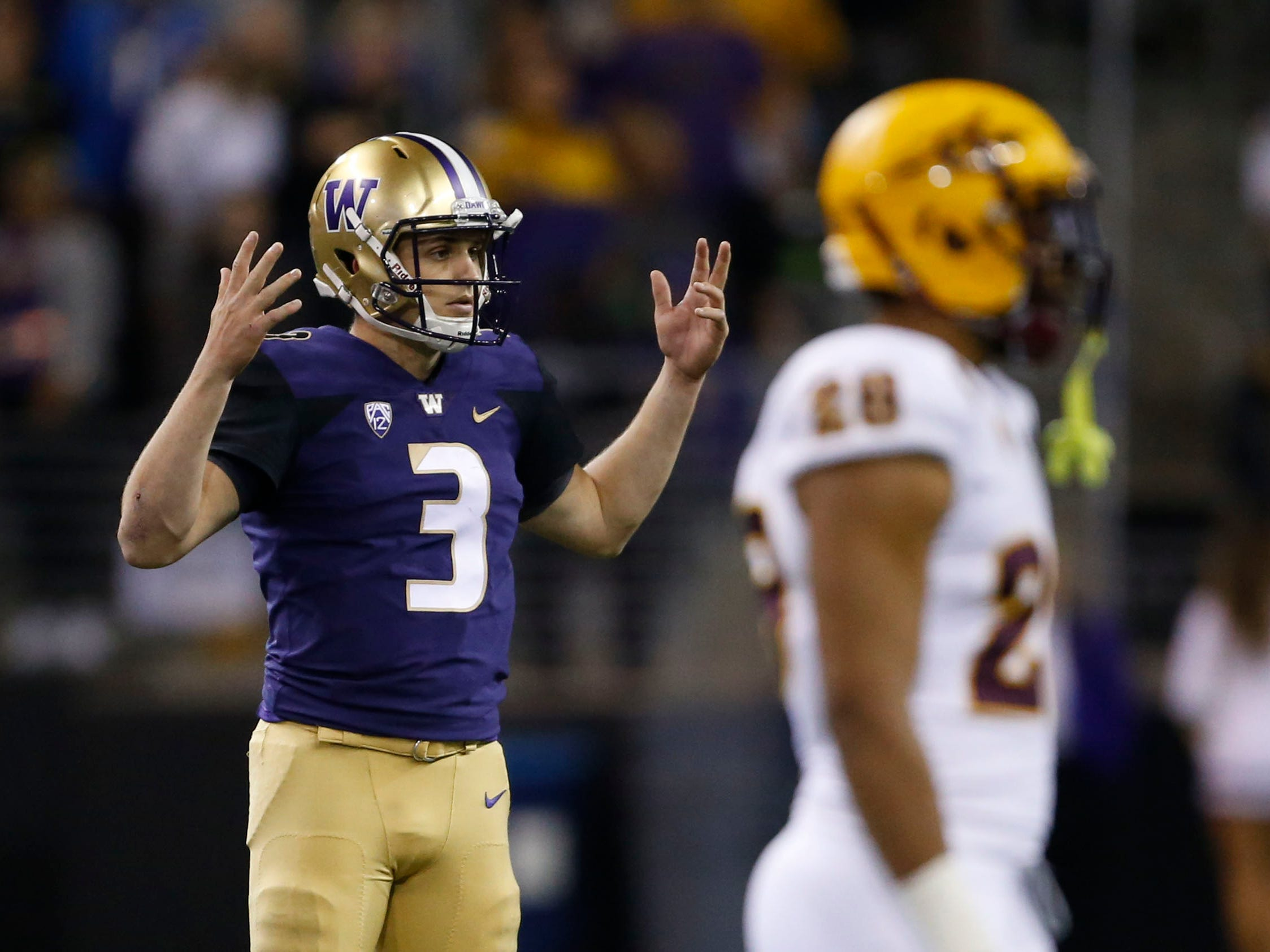 Sep 22, 2018; Seattle, WA, USA; Washington Huskies quarterback Jake Browning (3) questions an incomplete pass call against the Arizona State Sun Devils during the third quarter at Husky Stadium.