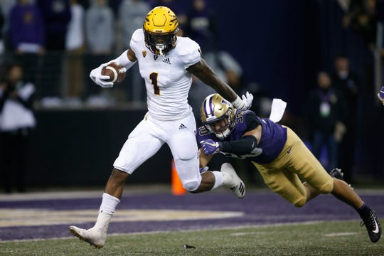 Sep 22, 2018; Seattle, WA, USA; Arizona State Sun Devils wide receiver N'Keal Harry (1) gets past a diving Washington Huskies linebacker Kyler Manu (30) on a punt return during the fourth quarter at Husky Stadium.