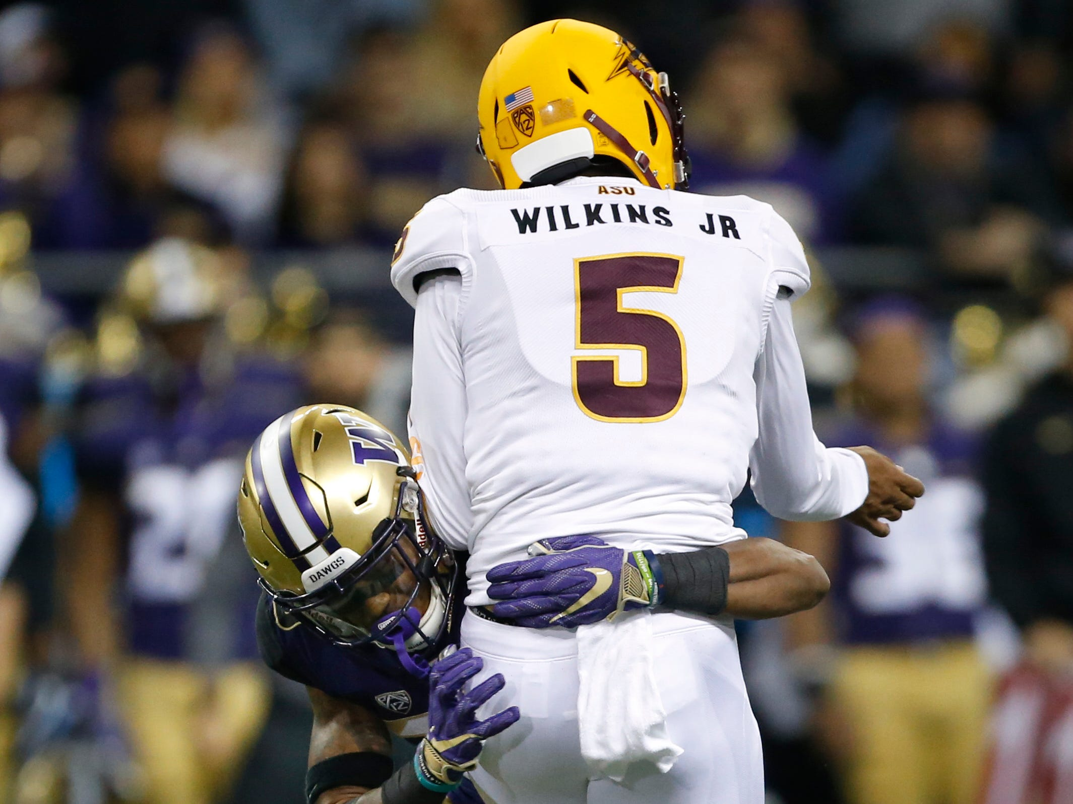 Sep 22, 2018; Seattle, WA, USA; Washington Huskies defensive back Jordan Miller (23) hits Arizona State Sun Devils quarterback Manny Wilkins (5) during the second quarter at Husky Stadium.