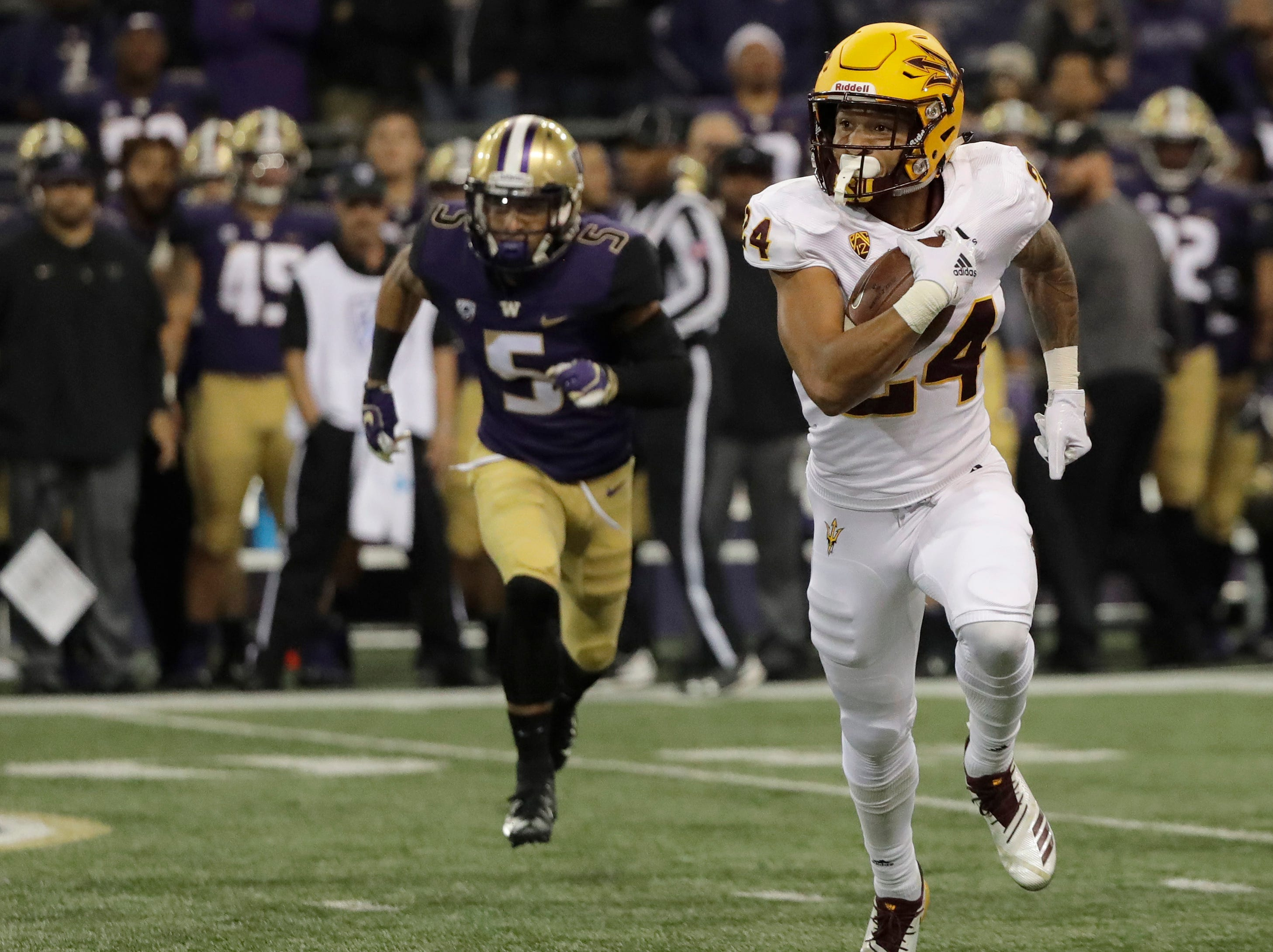 CORRECTS TO READ THAT BACCELLIA THREW THE PASS - Arizona State defensive back Chase Lucas, right, runs the ball after intercepting a pass intended from Washington wide receiver Andre Baccellia (5) during the first half of an NCAA college football game Saturday, Sept. 22, 2018, in Seattle.