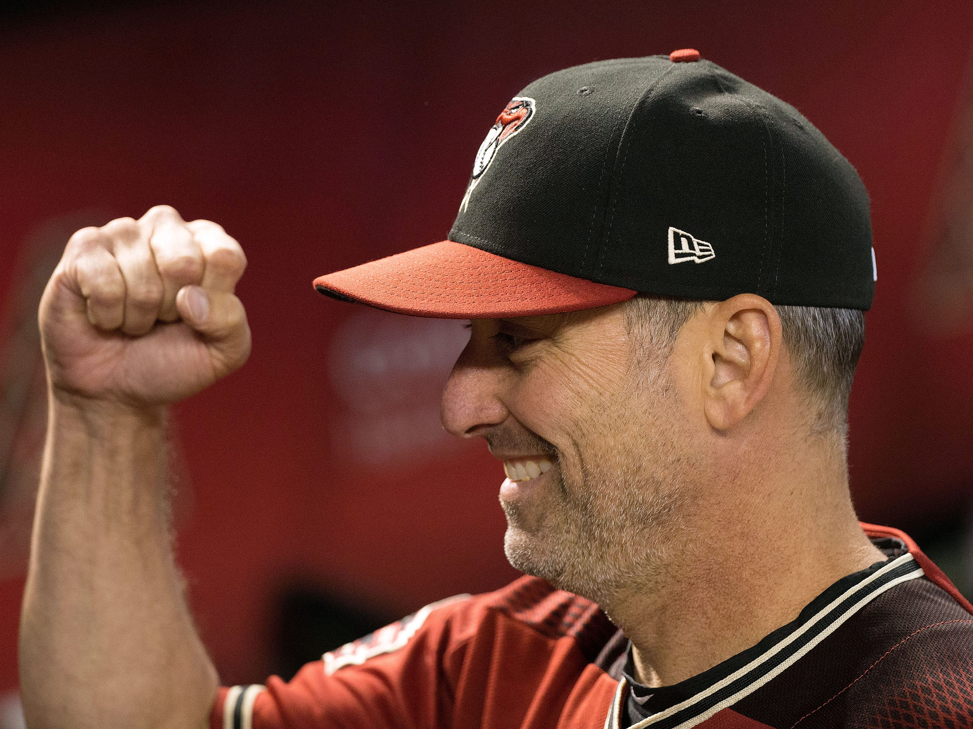 Sep 23, 2018; Phoenix, AZ, USA; Arizona Diamondbacks manager Torey Lovullo (17) celebrates with players prior to the start of the first inning against the Colorado Rockies at Chase Field. Mandatory Credit: Allan Henry-USA TODAY Sports