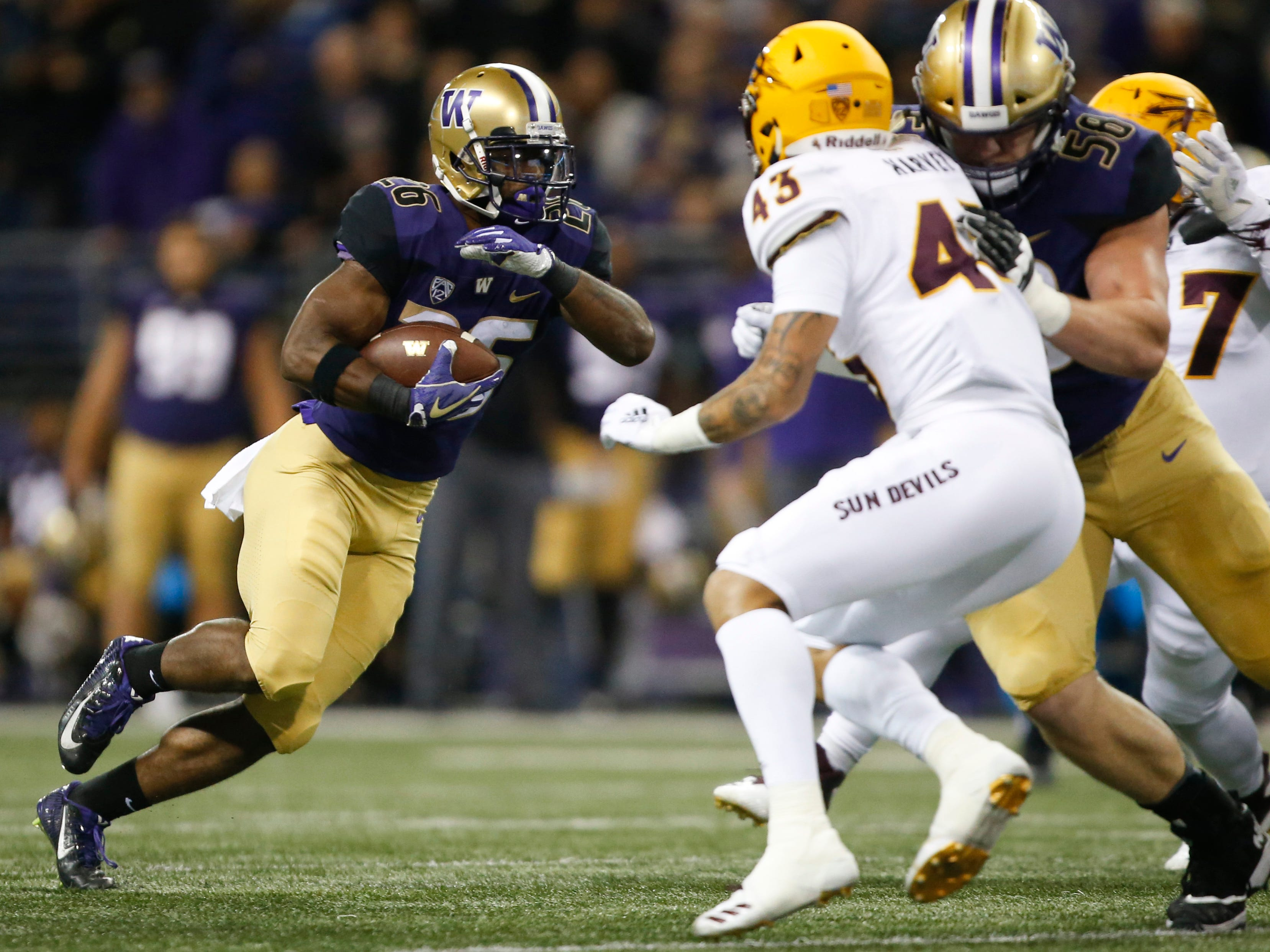Sep 22, 2018; Seattle, WA, USA; Washington Huskies running back Salvon Ahmed (26) rushes the ball against the Arizona State Sun Devils during the first quarter at Husky Stadium.