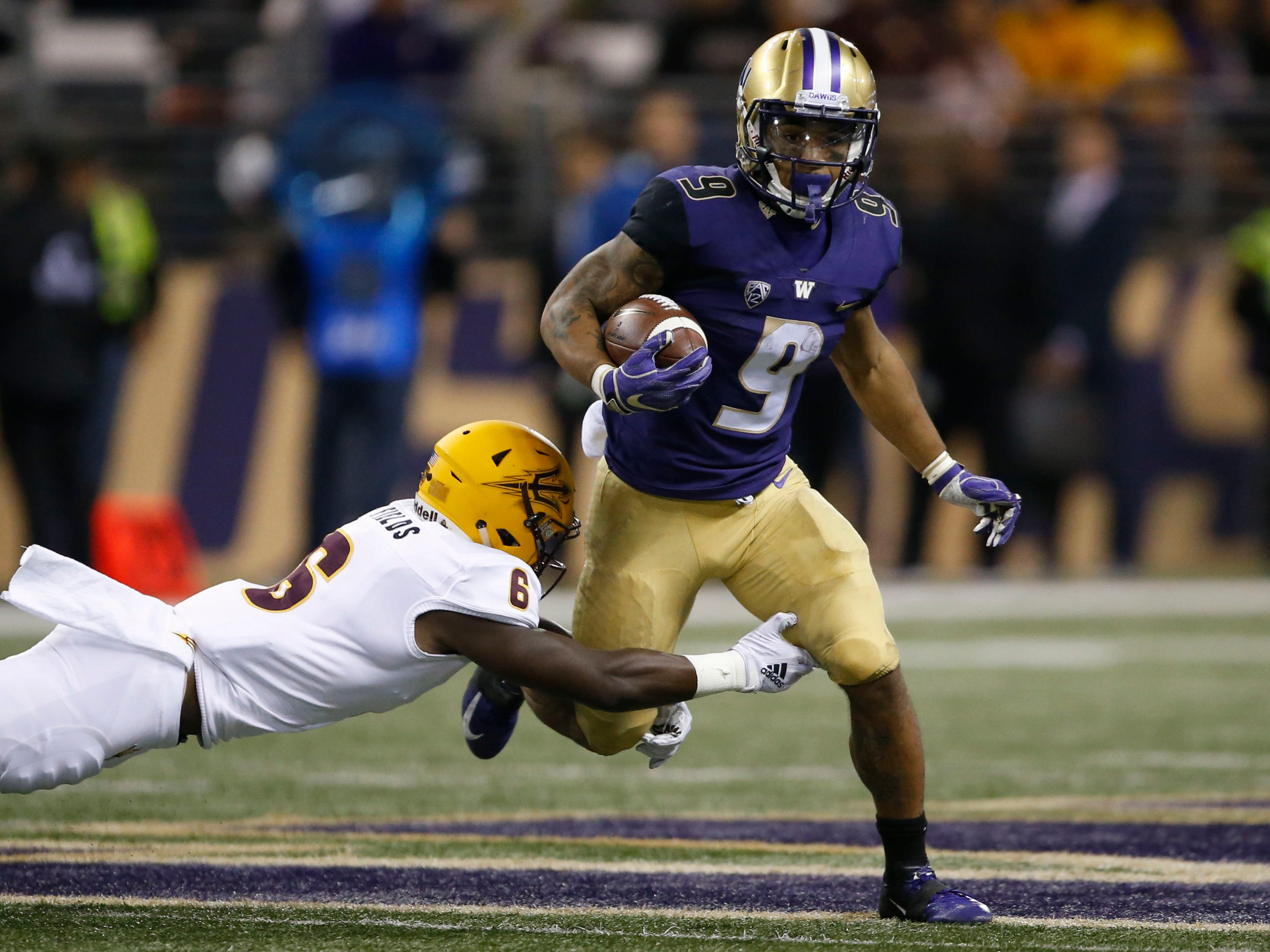 Sep 22, 2018; Seattle, WA, USA; Arizona State Sun Devils defensive back Evan Fields (6) tries to tackle Washington Huskies running back Myles Gaskin (9) during the fourth quarter at Husky Stadium.
