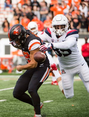 Sep 22, 2018; Corvallis, OR, USA; Oregon State Beavers punter Daniel Rodriguez (39) fumbles as he is tackled by Arizona Wildcats tight end Jamie Nunley (85) during the second half at Reser Stadium. The Arizona Wildcats won 35-14.
