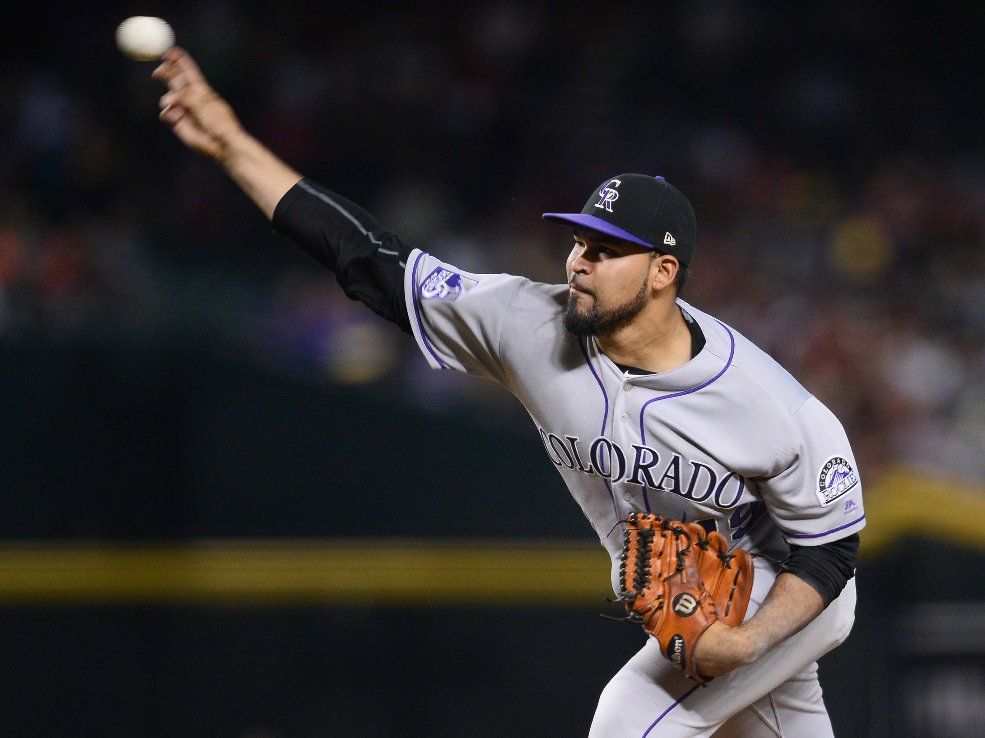 Sep 22, 2018; Phoenix, AZ, USA; Colorado Rockies starting pitcher Antonio Senzatela (49) pitches against the Arizona Diamondbacks during the first inning at Chase Field.