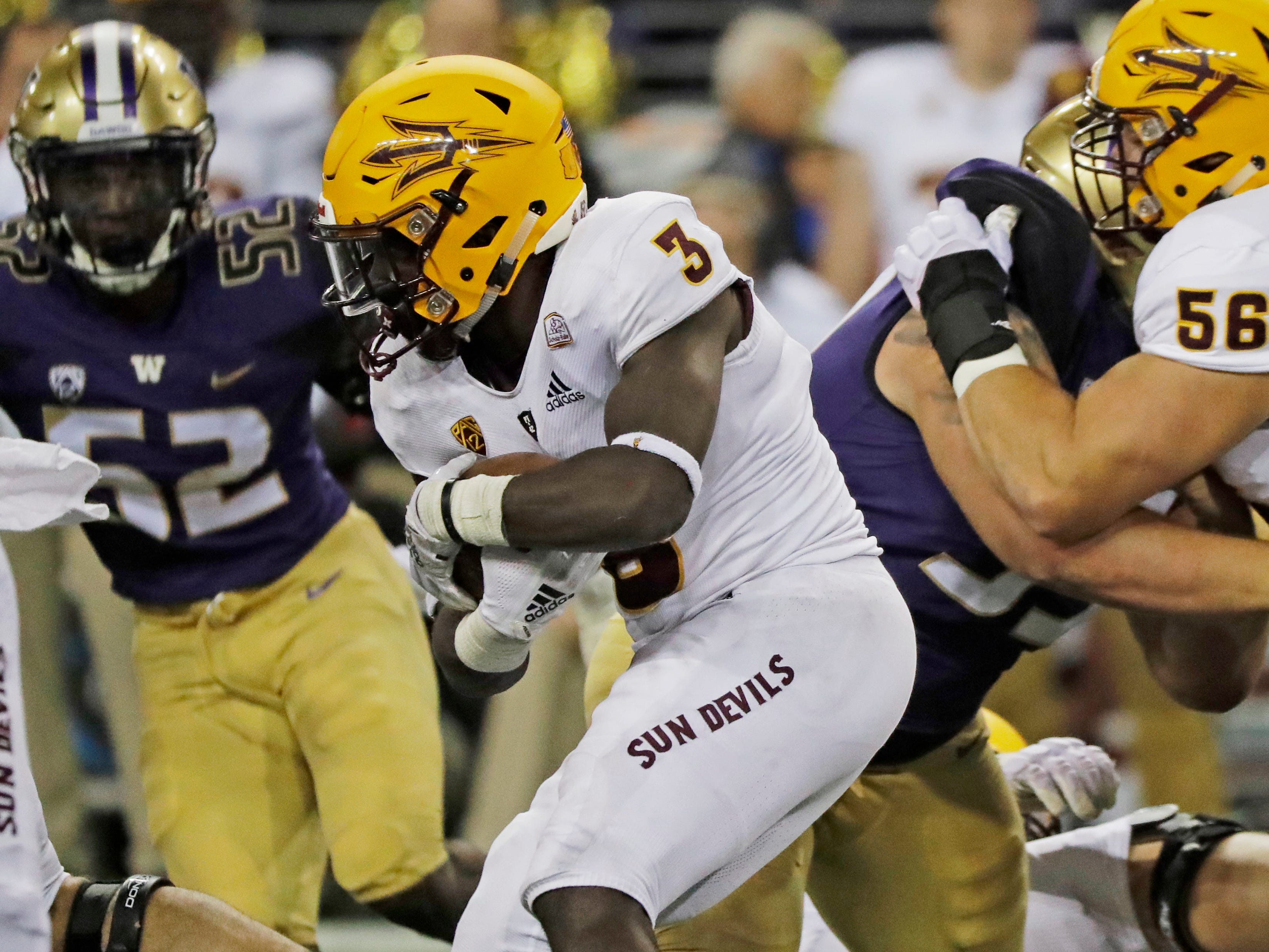 Arizona State running back Eno Benjamin (3) rushes against Washington during the first half of an NCAA college football game, Saturday, Sept. 22, 2018, in Seattle.
