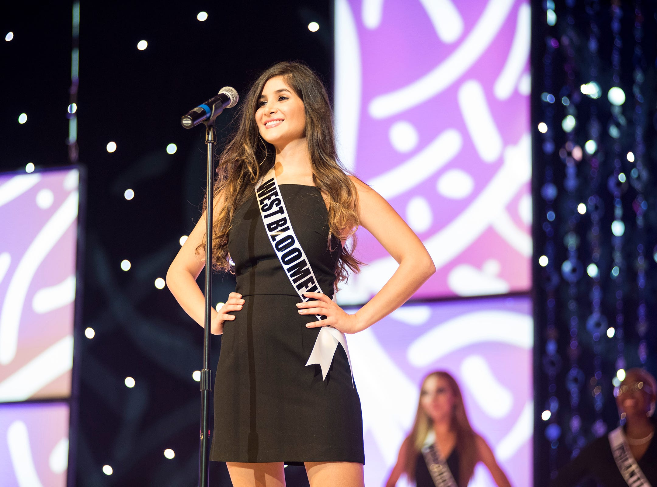 Miss West Bloomfield Sophia Cannella introduces herself Saturday, Sept. 22, 2018 at the start of the Miss Michigan USA competition at McMorran Theater.