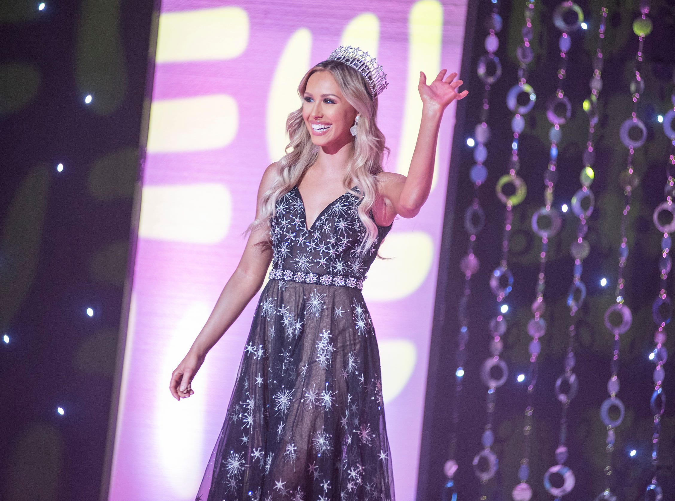 Miss Michigan USA 2018 Elizabeth Johnson walks onto the stage Saturday, Sept. 22, 2018 during the Miss Michigan USA pageant at McMorran Theater.