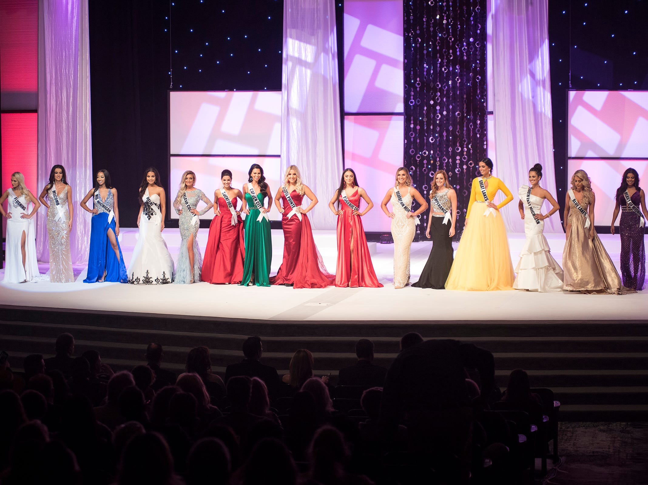 The 16 semifinalists in the Miss Michigan USA pageant line the stage after competing in the formal wear portion Saturday, Sept. 22, 2018 at McMorran Theater.