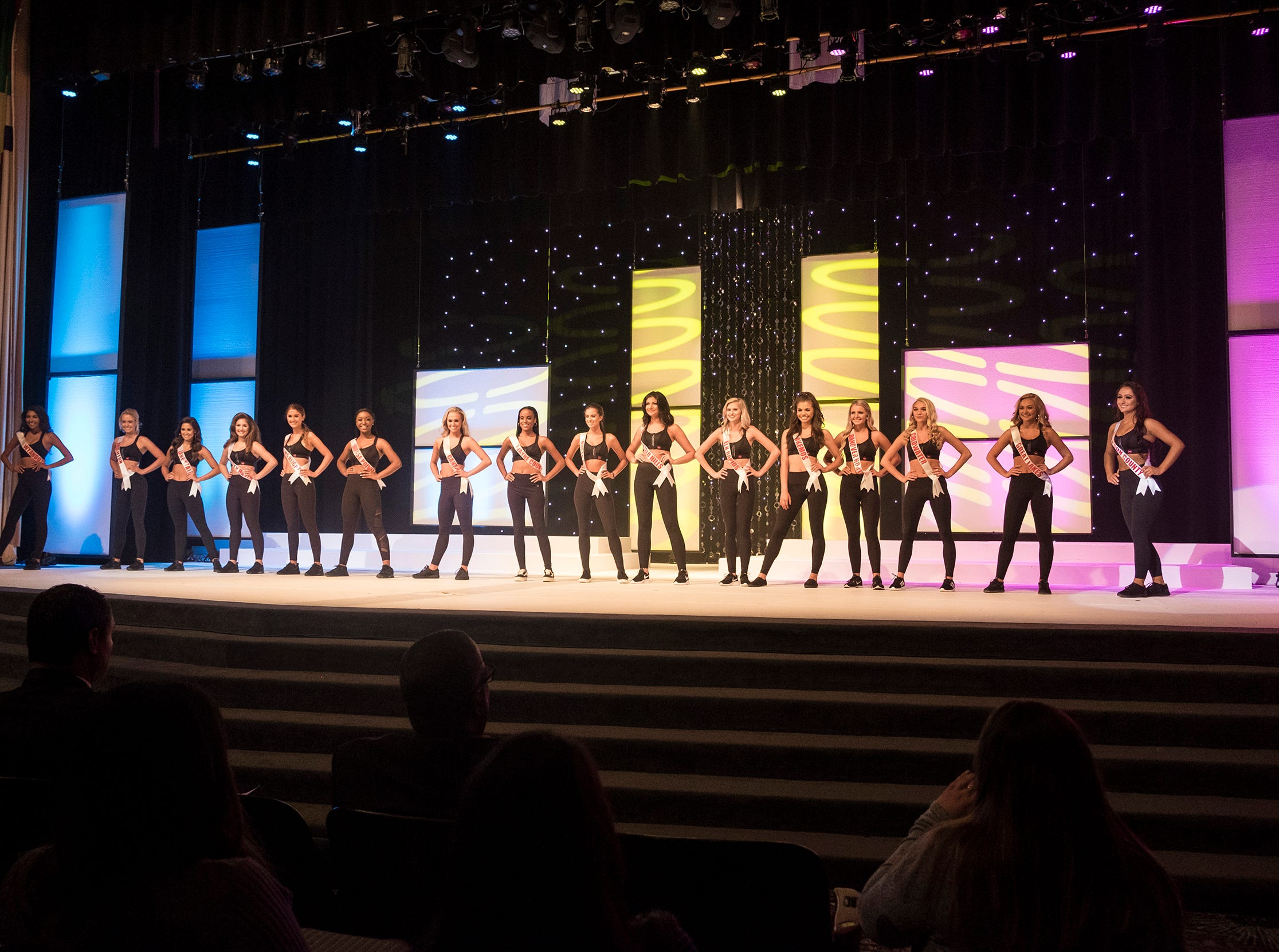 The 16 semifinalists in the Miss Michigan Teen USA pageant line the stage after competing in the active wear portion  Saturday, Sept. 22, 2018 at McMorran Theater.