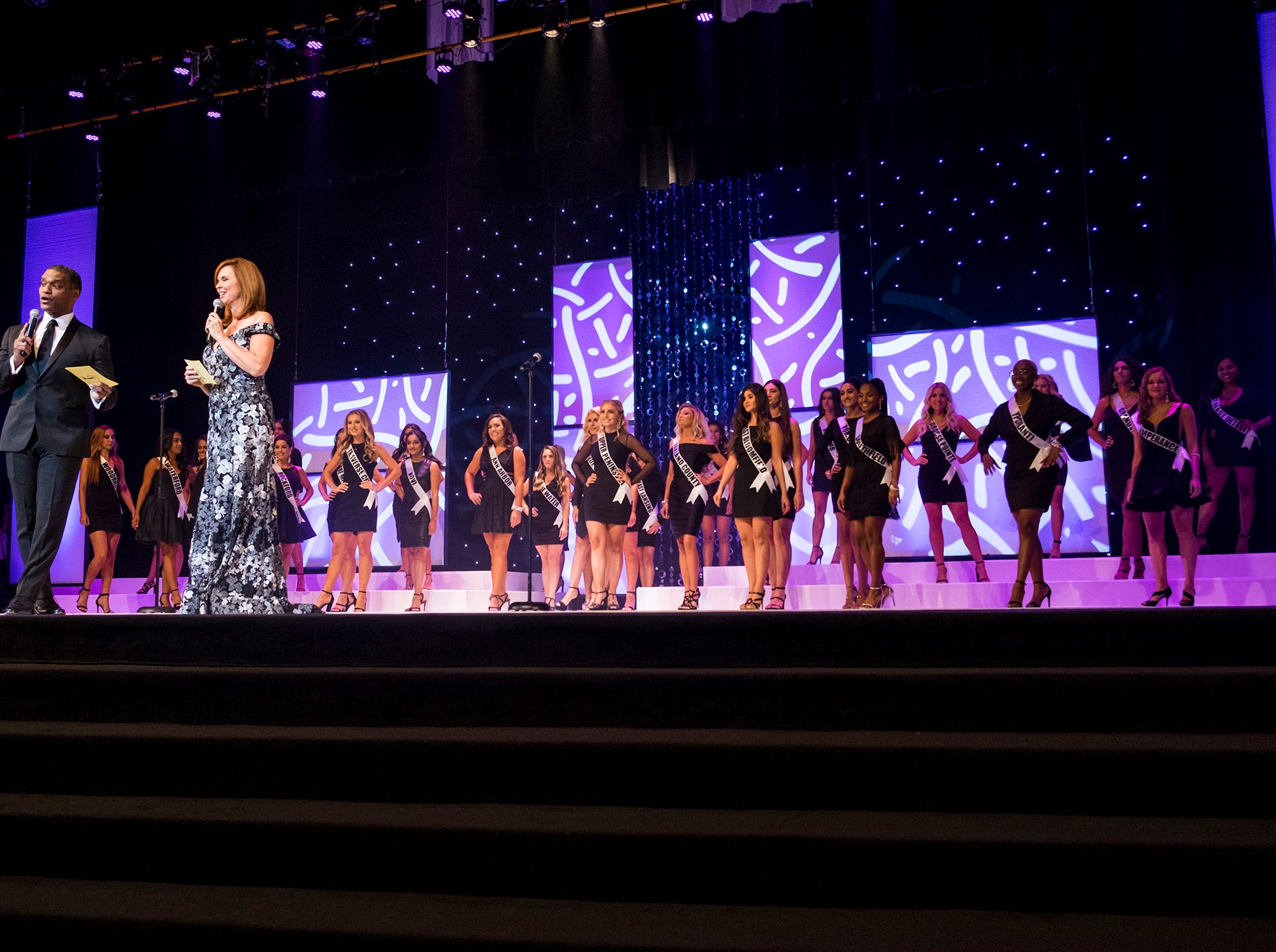Cincinnati TV personalities Rob Williams, left, and Sheila Gray give opening remarks Saturday, Sept. 22, 2018 during the Miss Michigan USA pageant at McMorran Theater.