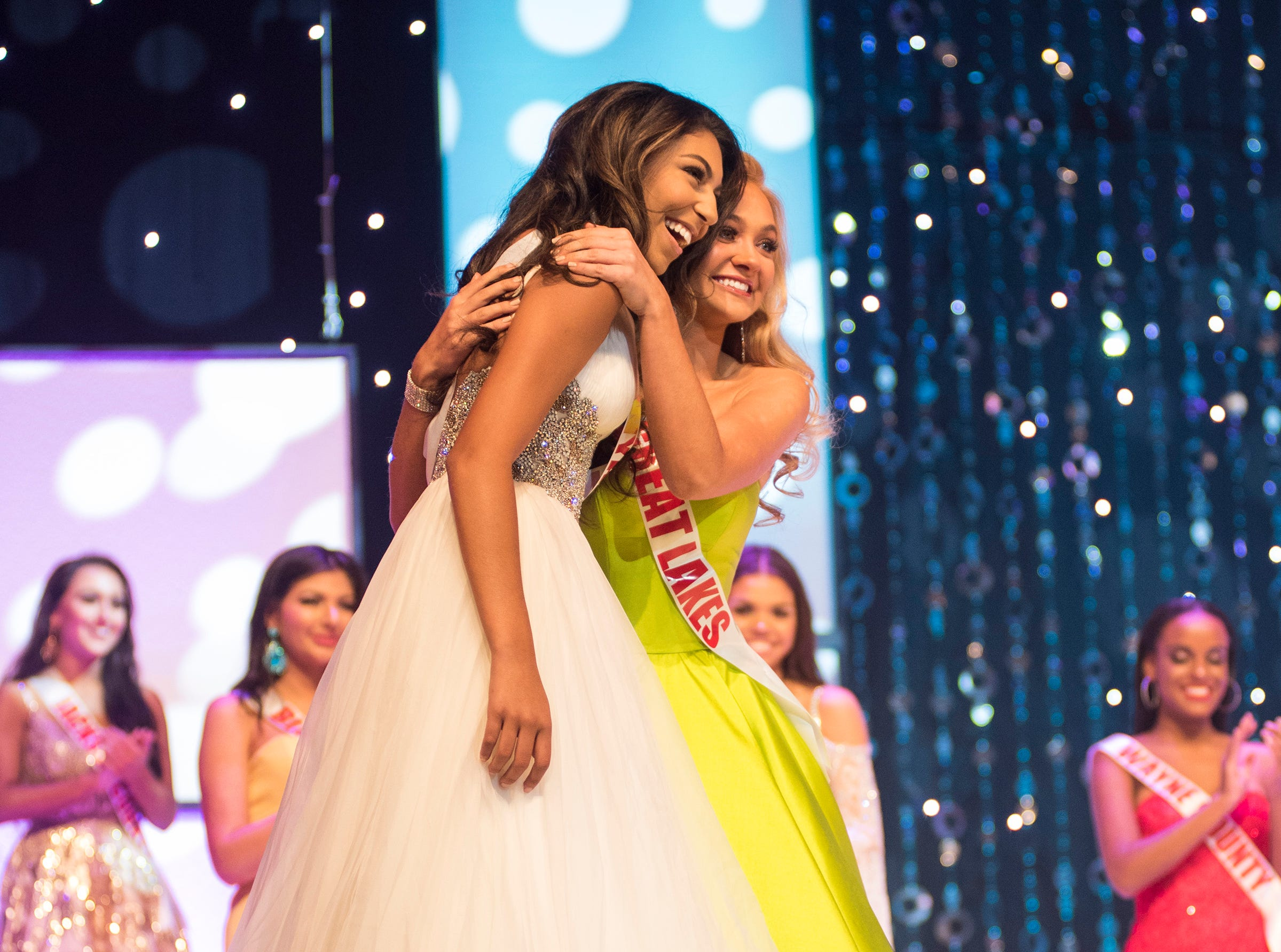 Miss Wyandotte Teen Alexis Fagan, left, is hugged by Miss Great Lakes Teen Rebecca Larsen after being chosen for the final round of the Miss Michigan Teen USA pageant Saturday, Sept. 22, 2018 at McMorran Theater.