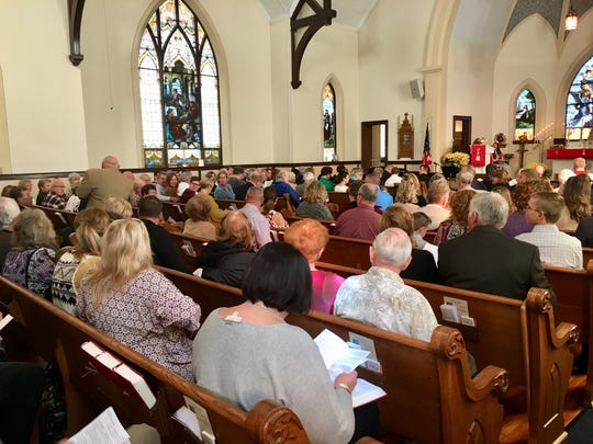 The congregation of St. John's Lutheran Church sits during a service commemorating the church's 100th anniversary.