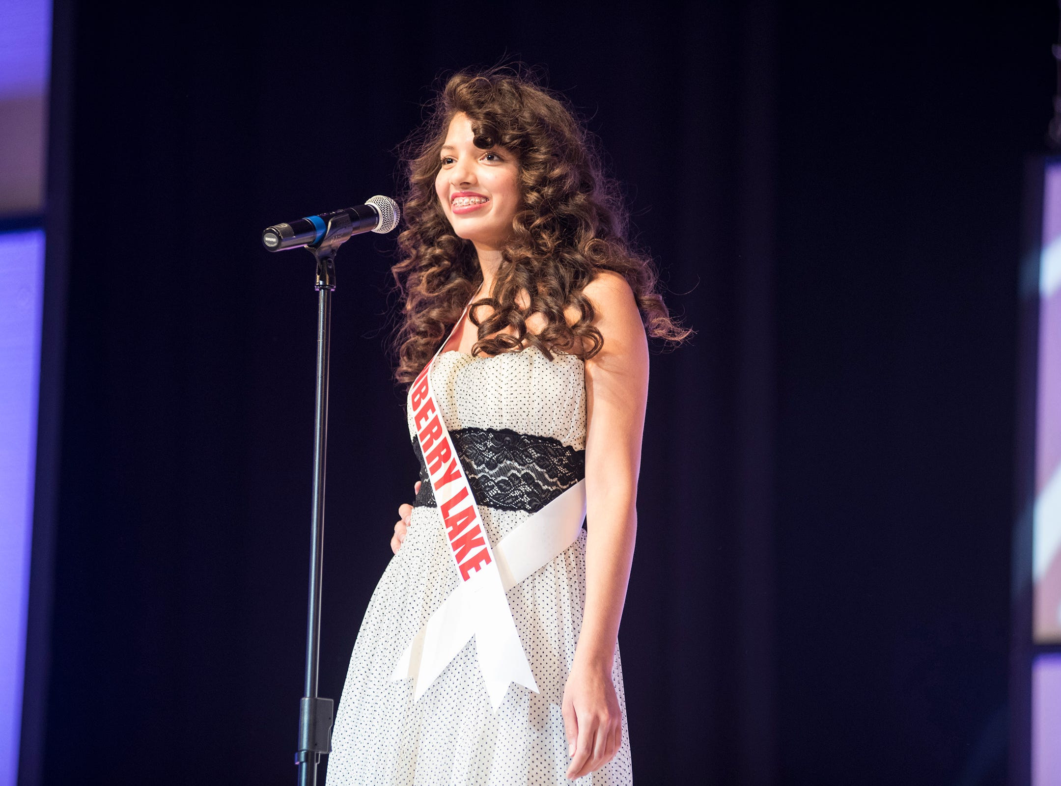 Miss Strawberry Lake Teen Emily Oliverio introduces herself Saturday, Sept. 22, 2018 at the start of the Miss Michigan Teen USA competition at McMorran Theater.