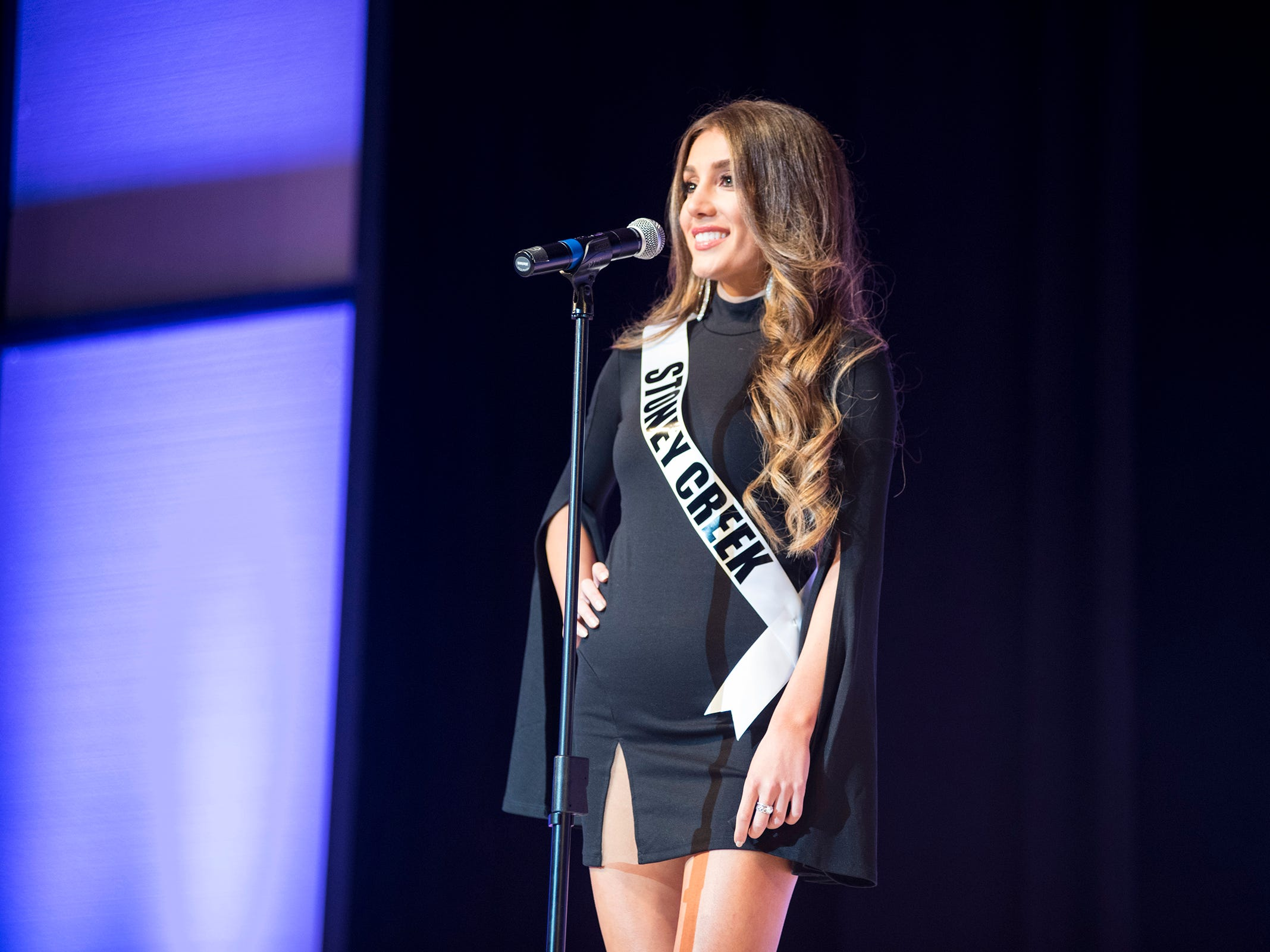 Miss Stoney Creek Mira Kasmikha introduces herself Saturday, Sept. 22, 2018 at the start of the Miss Michigan USA competition at McMorran Theater.