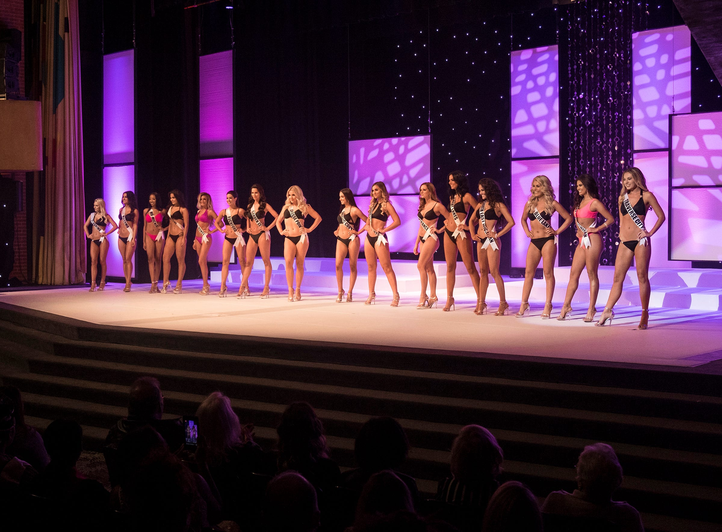The 16 semifinalists in the Miss Michigan USA pageant line the stage after competing in the swimsuit portion Saturday, Sept. 22, 2018 at McMorran Theater.