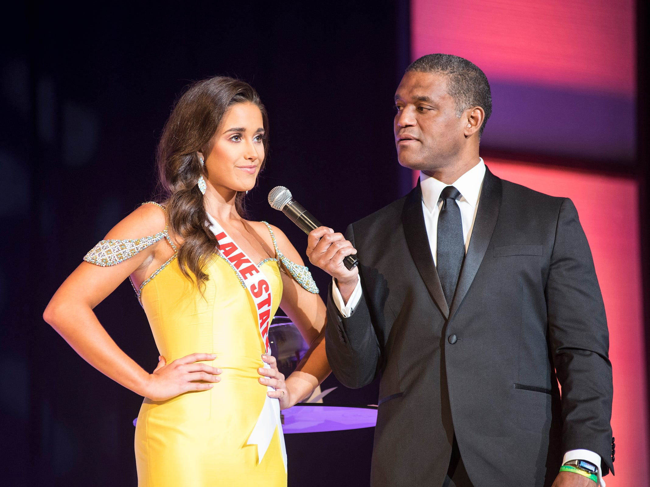 Miss Lake State Teen Keri Martin, left, is questioned by Cincinnati TV personality Rob Williams Saturday, Sept. 22, 2018 during the final round of the Miss Michigan Teen USA pageant at McMorran Theater.
