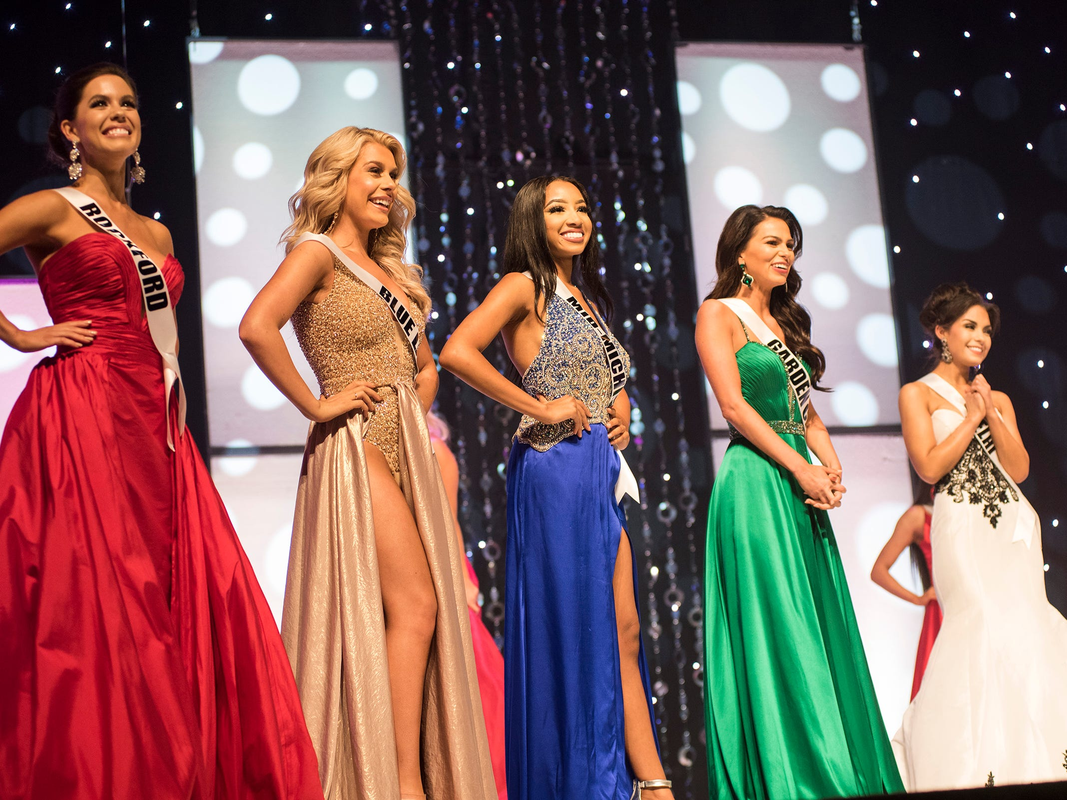 The finalists in the Miss Michigan USA pageant line up on stage Saturday, Sept. 22, 2018 during the Miss Michigan Teen USA pageant at McMorran Theater.