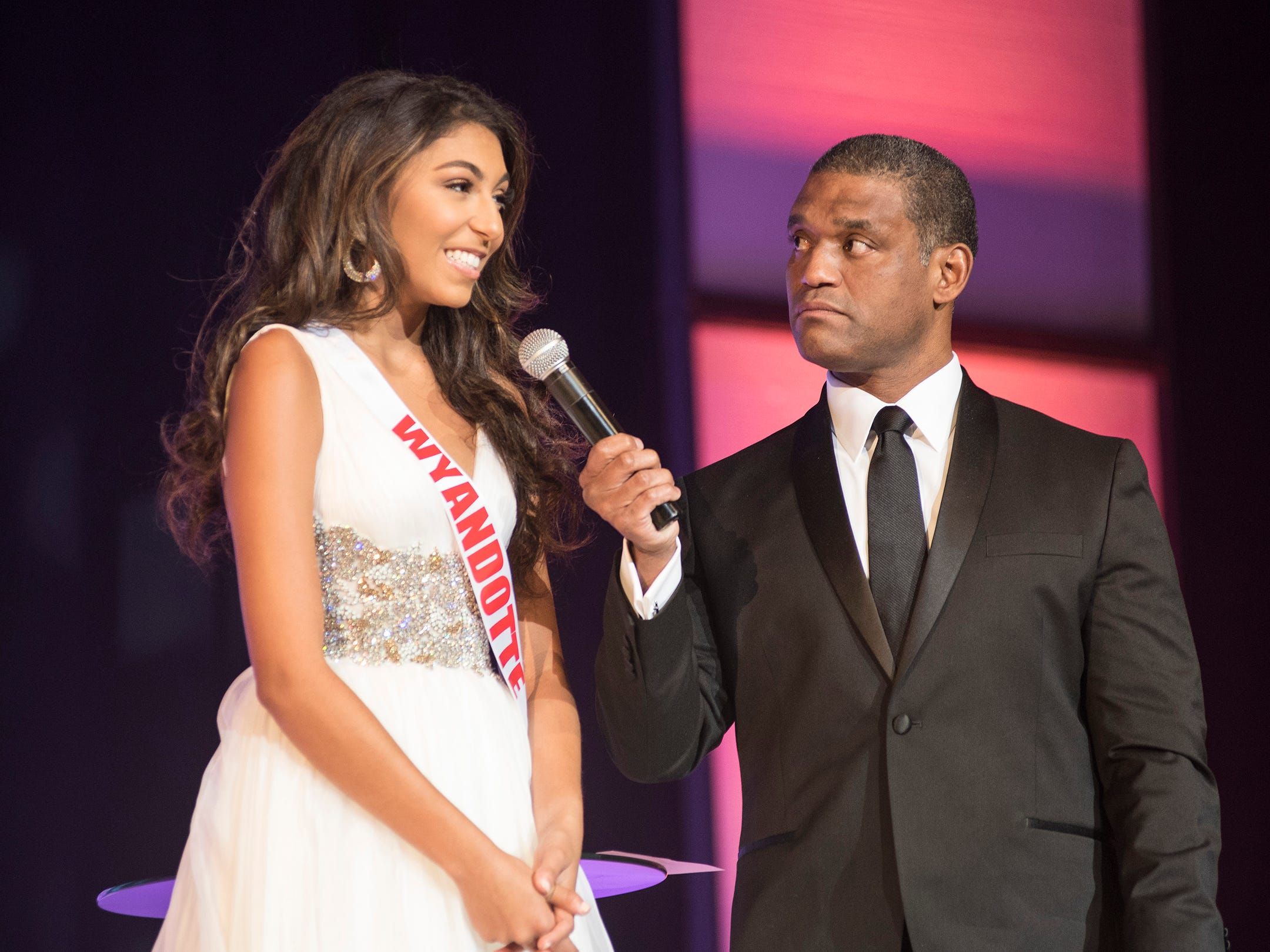 Miss Wyandotte Teen Alexis Fagan, left, is questioned by Cincinnati TV personality Rob Williams Saturday, Sept. 22, 2018 during the final round of the Miss Michigan Teen USA pageant at McMorran Theater.