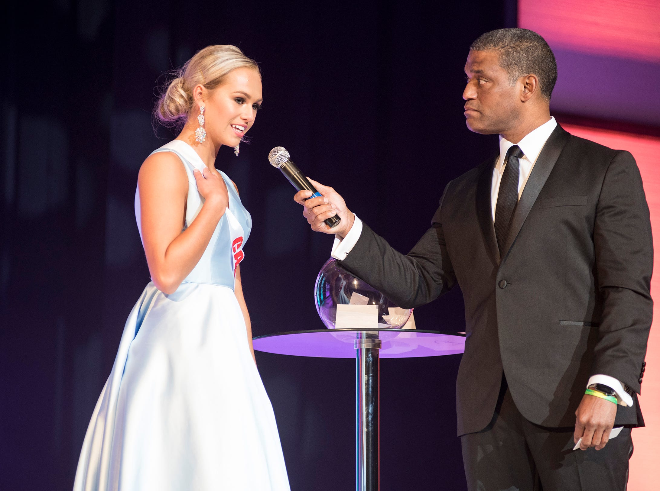 Miss Canton Teen Alexis Lubecki, left, is questioned by Cincinnati TV personality Rob Williams Saturday, Sept. 22, 2018 during the final round of the Miss Michigan Teen USA pageant at McMorran Theater.