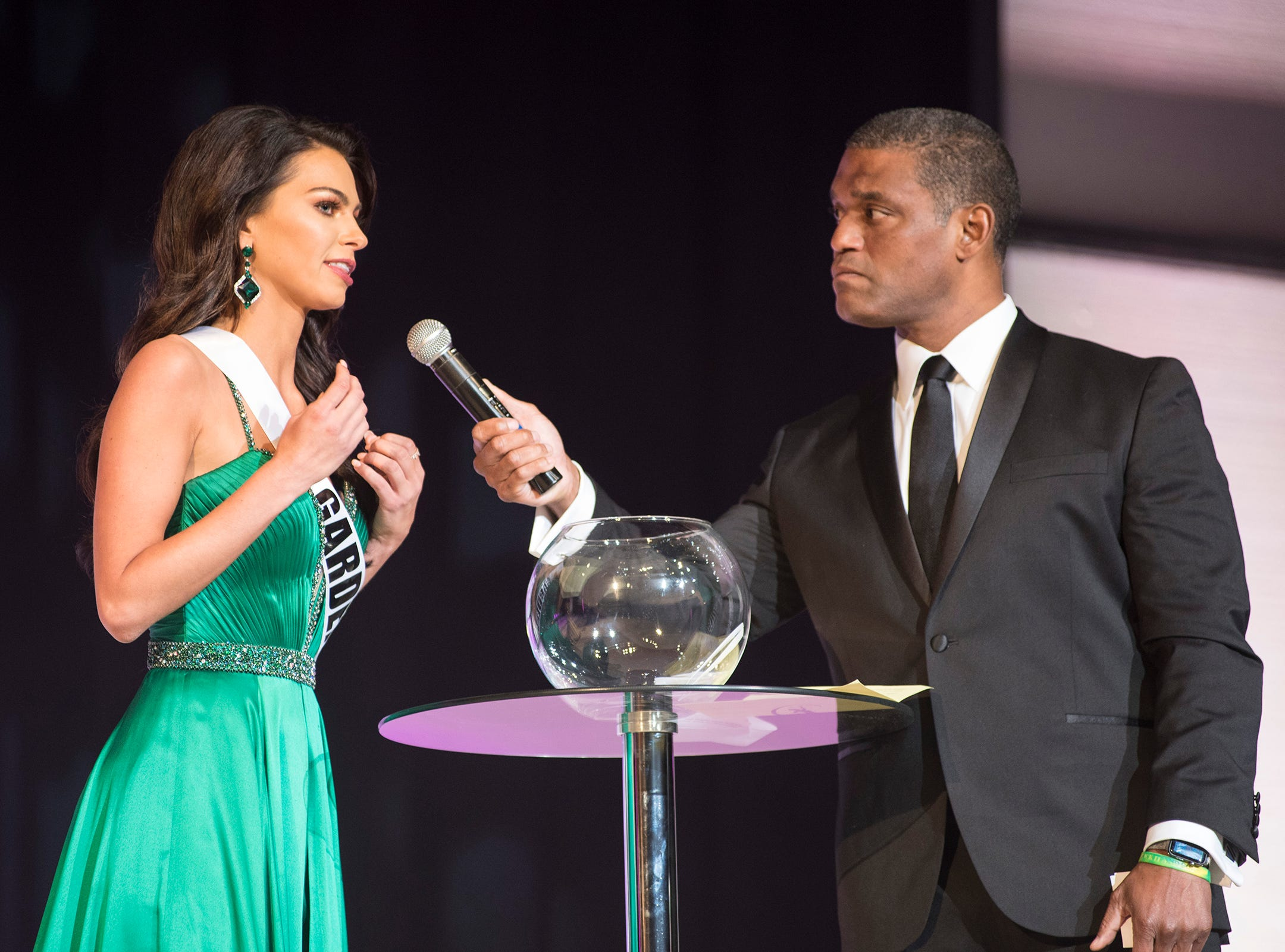 Miss Garden City Alyse Madej, left, is questioned by Cincinnati TV personality Rob Williams Saturday, Sept. 22, 2018 during the final round of the Miss Michigan USA pageant at McMorran Theater.
