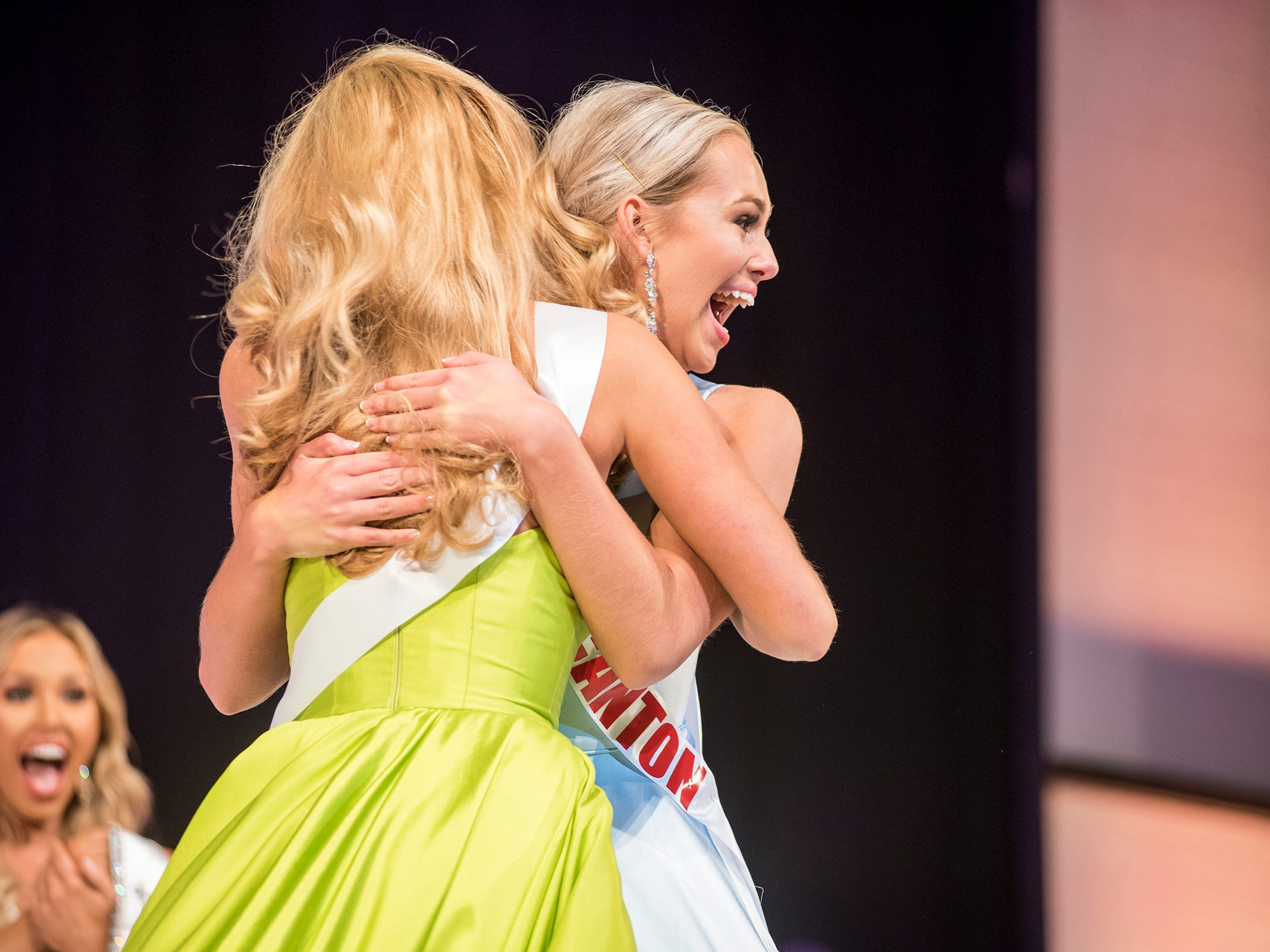 Miss Canton Teen Alexis Lubecki, right, hugs Miss Great Lakes Teen Rebecca Larsen after being named Miss Michigan Teen USA Saturday, Sept. 22, 2018 during the Miss Michigan Teen USA pageant at McMorran Theater.
