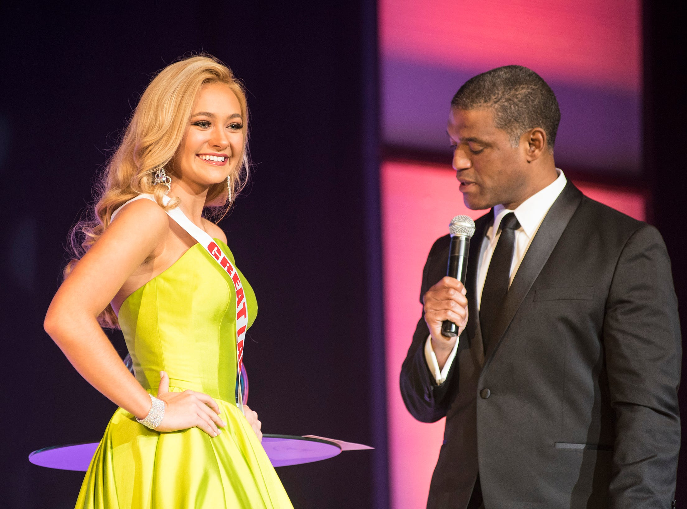 Miss Great Lakes Teen Rebecca Larsen, left, is questioned by Cincinnati TV personality Rob Williams Saturday, Sept. 22, 2018 during the final round of the Miss Michigan Teen USA pageant at McMorran Theater.