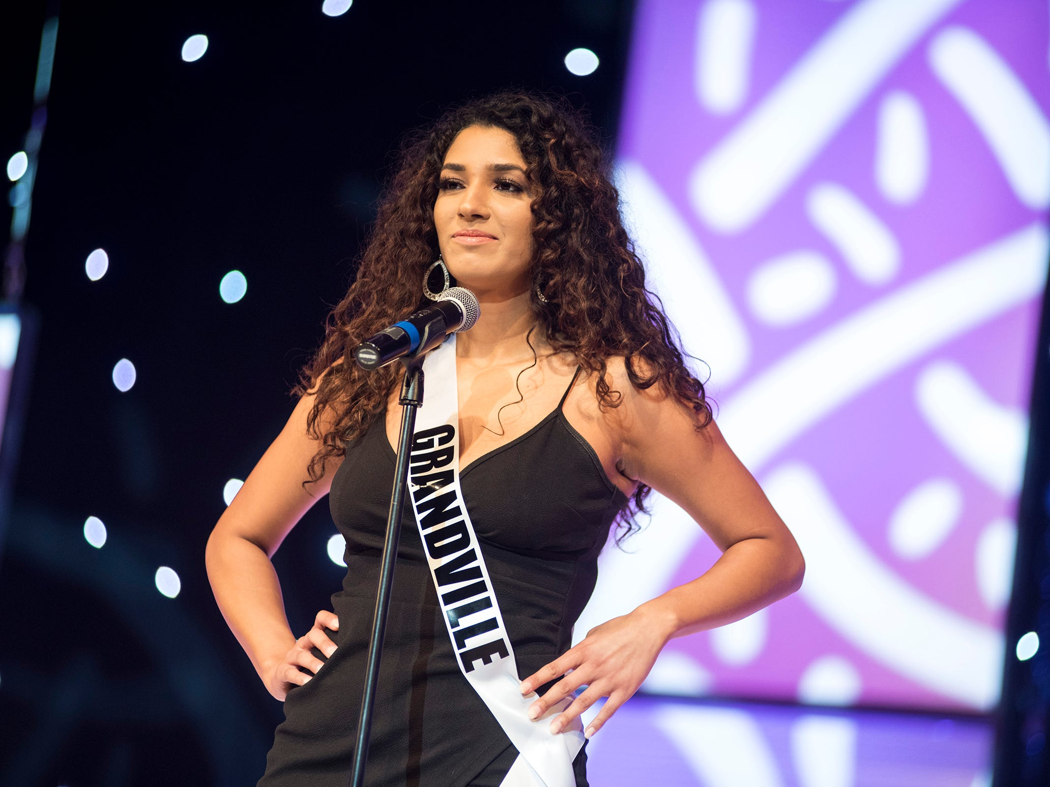 Miss Grandville Ariana Martinez introduces herself Saturday, Sept. 22, 2018 at the start of the Miss Michigan USA competition at McMorran Theater.