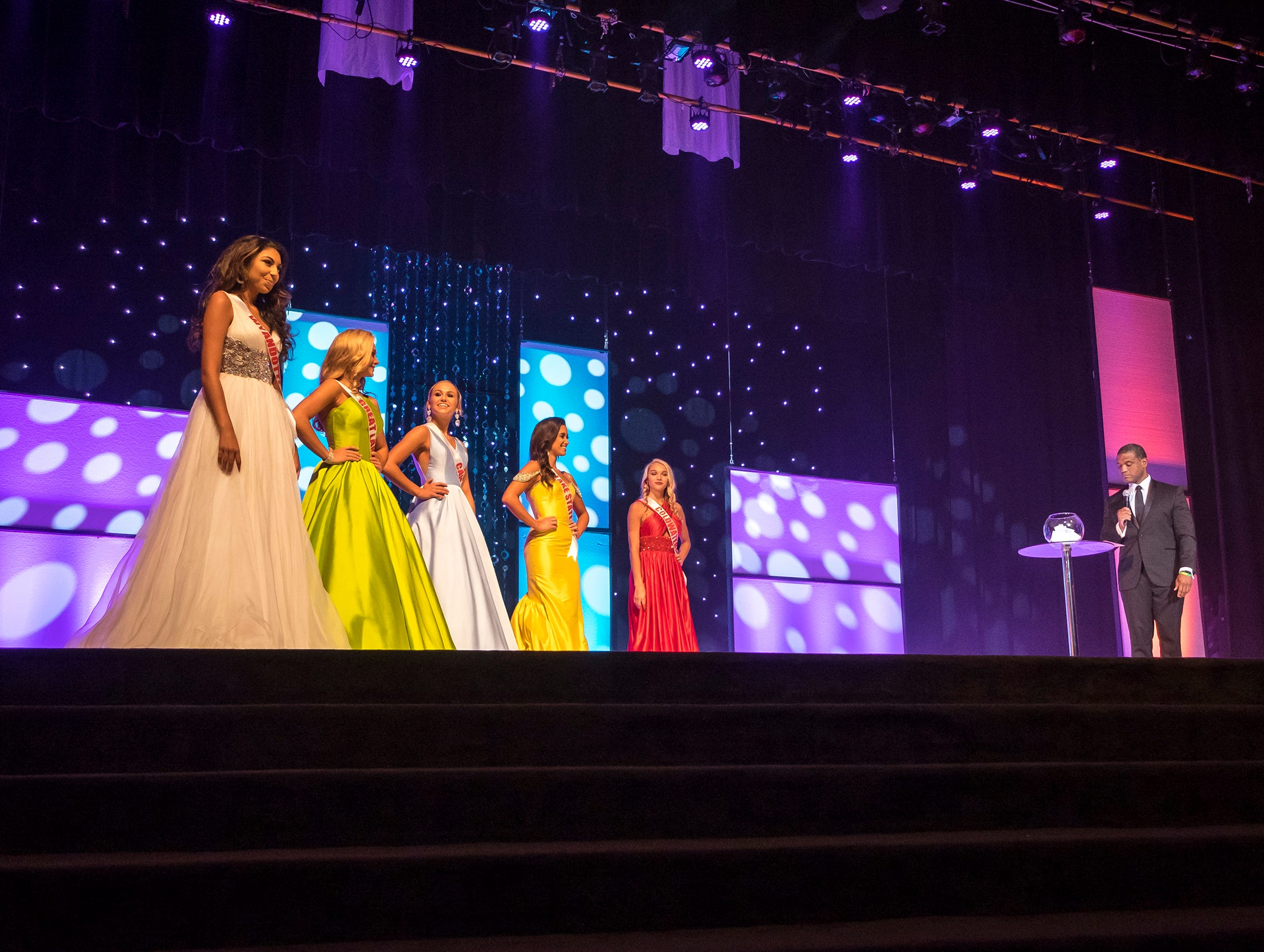 The finalists in the Miss Michigan Teen USA pageant wait for questioning from TV personality Rob Williams, right, Saturday, Sept. 22, 2018 during the Miss Michigan Teen USA pageant at McMorran Theater.