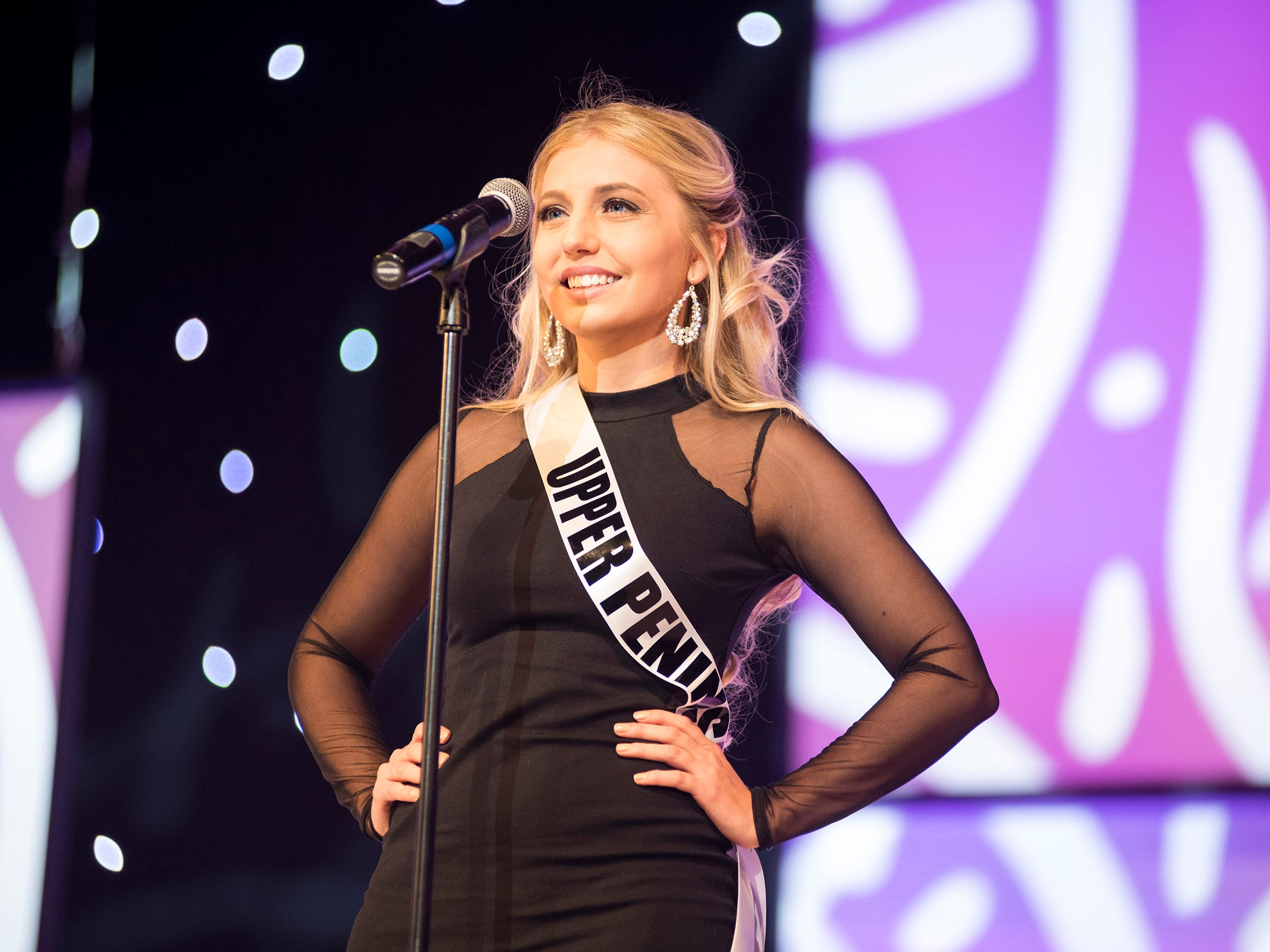 Miss Upper Peninsula Macy Niemisto introduces herself Saturday, Sept. 22, 2018 at the start of the Miss Michigan USA competition at McMorran Theater.