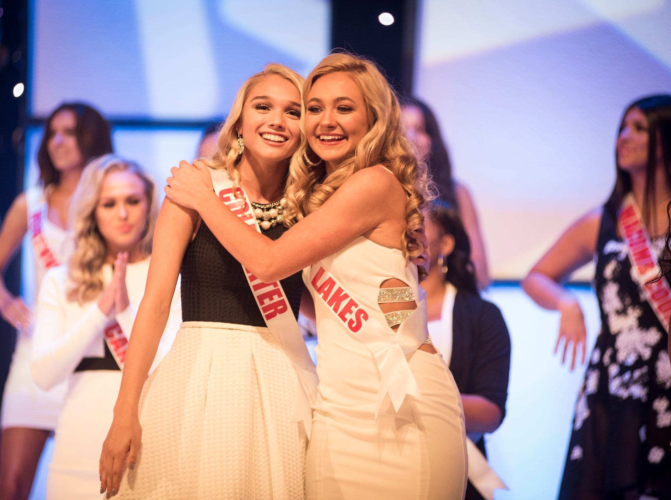 Miss Great Lakes Teen Rebecca Larsen, right, hugs Miss Coldwater Teen Erica Rodgers after being selected for the semifinal round of the Miss Michigan Teen USA pageant Saturday, Sept. 22, 2018 at McMorran Theater.