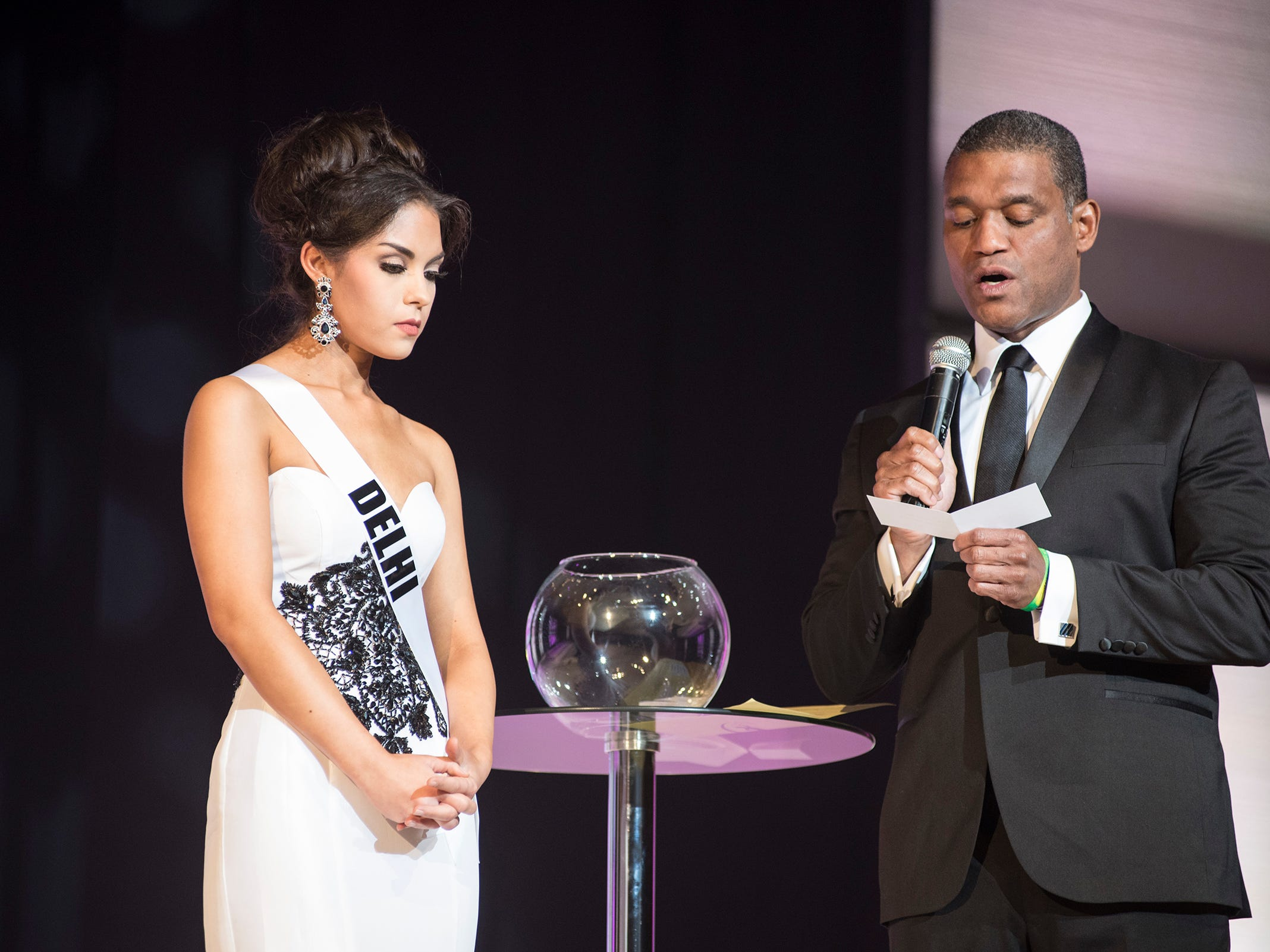 Miss Delhi Victoria Davis, left, is questioned by Cincinnati TV personality Rob Williams Saturday, Sept. 22, 2018 during the final round of the Miss Michigan USA pageant at McMorran Theater.
