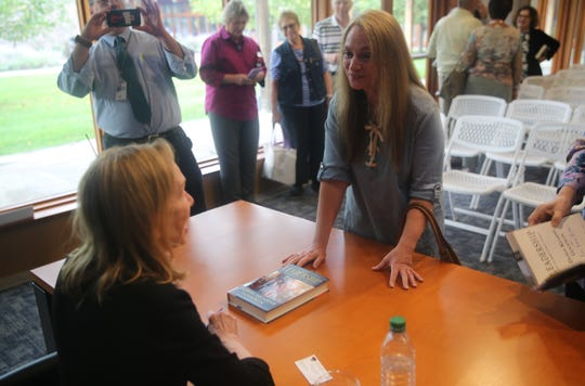 "Natalie Casale, of New Jersey, speaks with biographer Doris Kearns Goodwin on Saturday after her talk at the FDR Library. Casale said she teaches leadership questions at Berkeley College and often asks the question, ""Are leaders born or made?"""