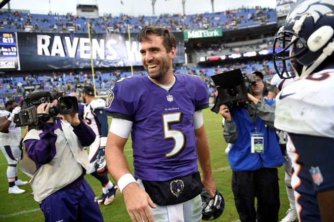 Baltimore Ravens quarterback Joe Flacco laughs after an NFL football game against the Denver Broncos, Sunday, Sept. 23, 2018, in Baltimore. Baltimore won 27-14. (AP Photo/Nick Wass)