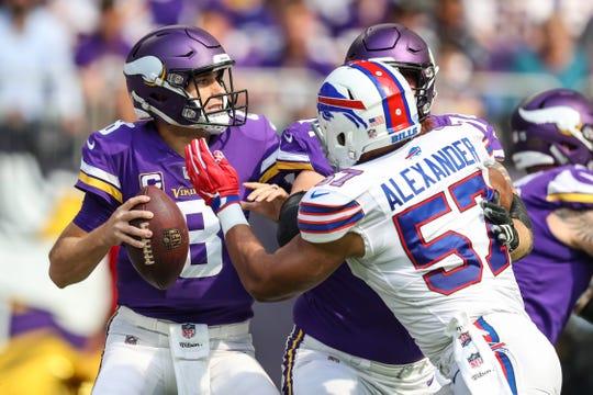 Minnesota Vikings quarterback Kirk Cousins  is pressured by Buffalo Bills linebacker Lorenzo Alexander.