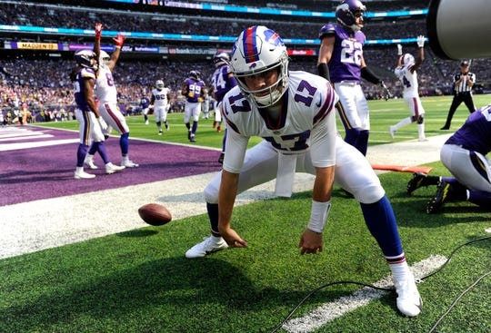 Josh Allen celebrates after scoring a touchdown in the first quarter of the game against the Minnesota Vikings.