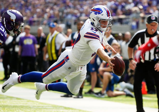 Buffalo Bills quarterback Josh Allen dives to the end zone during a 10-yard touchdown run during the first half of an NFL football game against the Minnesota Vikings.