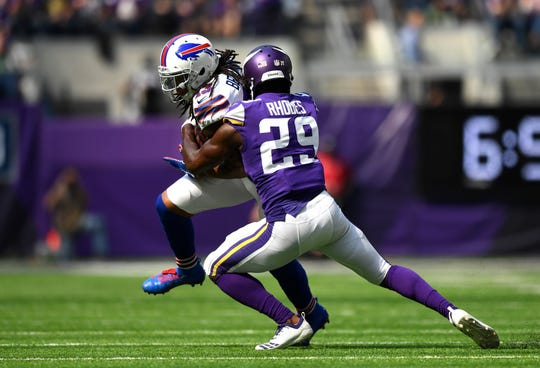 Kelvin Benjamin of the Buffalo Bills is tackled by Xavier Rhodes of the Minnesota Vikings in the second quarter.