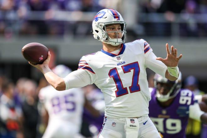 Buffalo Bills quarterback Josh Allen (17) throws a pass  during the first quarter against Minnesota Vikings at U.S. Bank Stadium.
