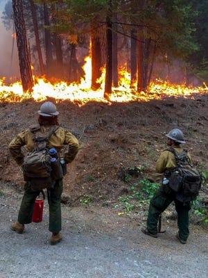 A U.S. Forest Service fire crew monitors the Delta Fire.