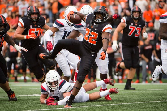 Sep 22, 2018; Corvallis, OR, USA; Oregon State Beavers running back Jermar Jefferson (22) leaps over an Arizona Wildcats defender to pick up a first down during the second half at Reser Stadium. The Arizona Wildcats won 35-14. Mandatory Credit: Troy Wayrynen-USA TODAY Sports