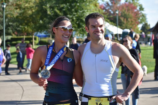 Megan and Carl Newton are the fastest female and male to complete the sprint triathlon event.