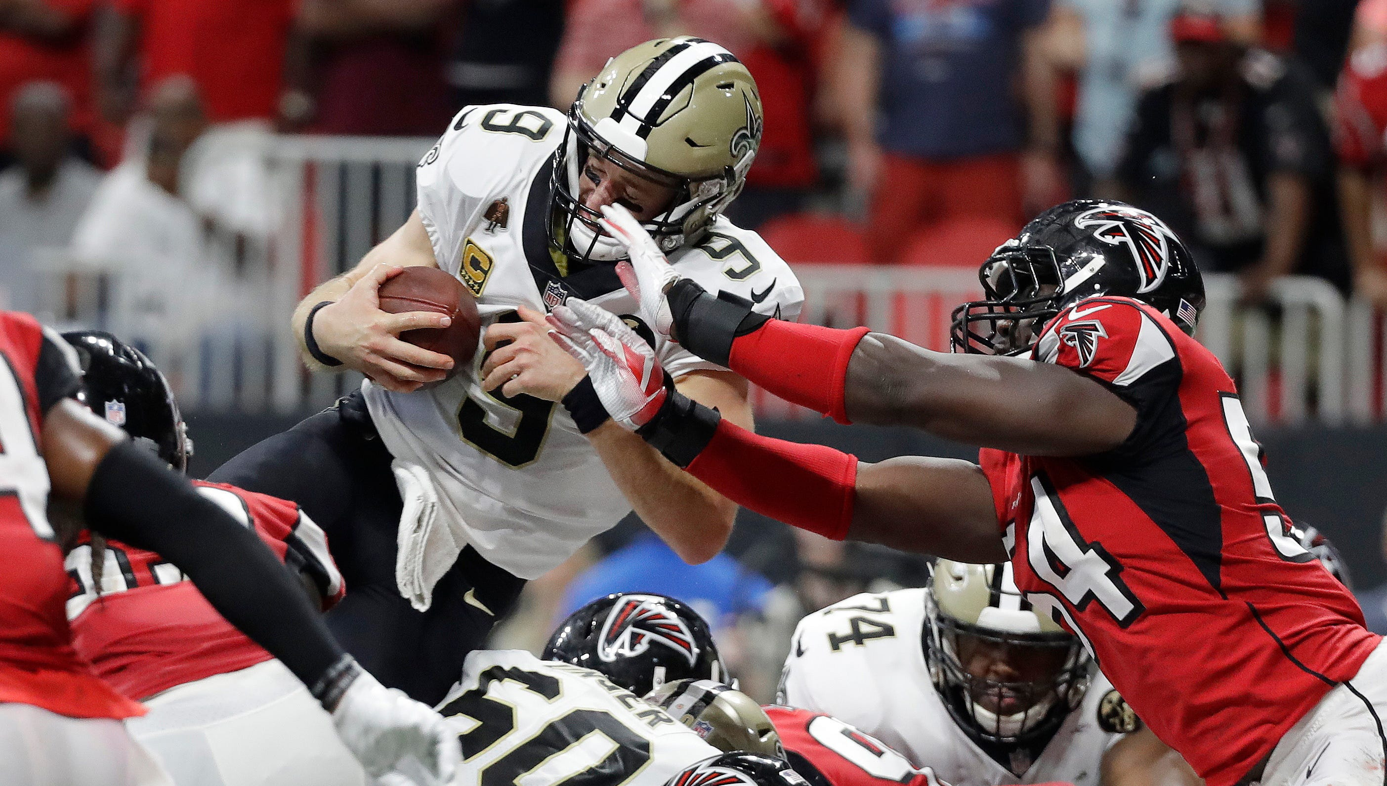 Drew Brees' touchdown run in overtime lifts Saints past Falcons in record-setting day