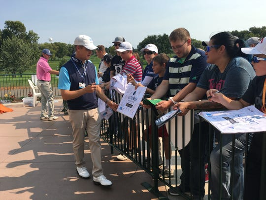 David Toms signs autographs for fans following his round Sunday afternoon at the Sanford International at Minnehaha Country Club.