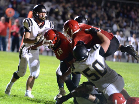 Riverheads' Zac Smiley follows Justin McWhorter (18) into the end zone for the Gladiators' fourth touchdown of the first half Saturday night.
