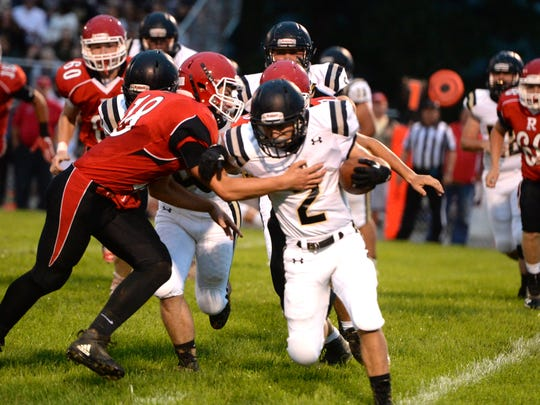 Riverheads' Justin McWhorter tries to bring down Buffalo Gap's Colin Bowers (2) during Saturday night's football game.