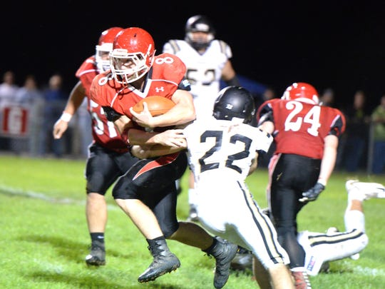 Riverheads' Zac Smiley (8) tries to break free of Buffalo Gap's Matthew Sheffer (22) Saturday night.
