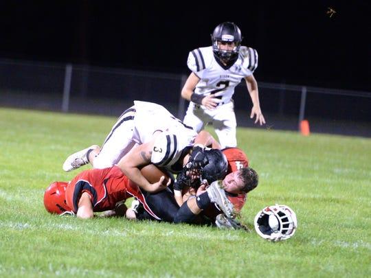 Riverheads' Blake Smith (4) loses his helmet while tackling Buffalo Gap's Cody McCray Saturday during a Shenandoah District football game.